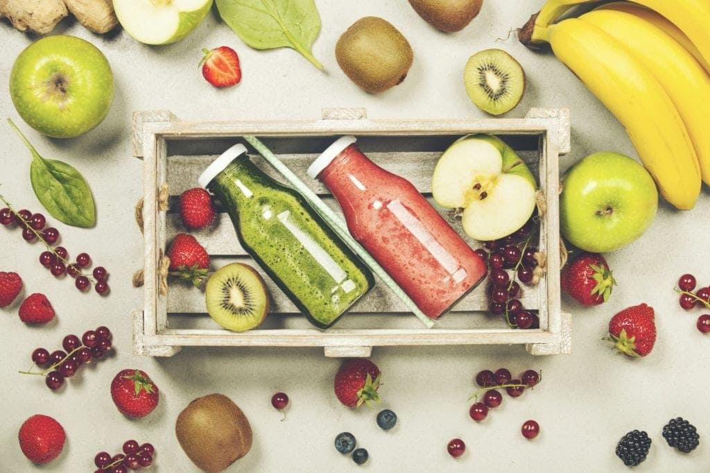 Green and red fresh juices or smoothies